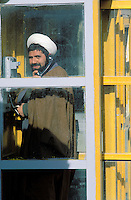 Shia mollah in the telephone cab - Teheran - Iran