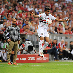 31.07.2013, Allianz Arena, Muenchen, Audi Cup 2013, FC Bayern Muenchen vs Sao Paulo, im Bild, REINALDO (Sao Paulo FC) nimmt den Ball in der Luft an. Hinten Trainer Pep GUARDIOLA (FC Bayern Muenchen) // during the Audi Cup 2013 match between FC Bayern Muenchen and Sao Paulon at the Allianz Arena, Munich, Germany on 2013/07/31. EXPA Pictures © 2013, PhotoCredit: EXPA/ Eibner/ Wolfgang Stuetzle<br /> <br /> ***** ATTENTION - OUT OF GER *****