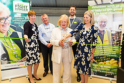 Mayor of Ashford Cllr Jesamy Blanford, assisted by Kent High Sheriff Jane Ashton, right, cut the ribbon at the opening of FareShare's relocated warehouse in Ashford, Kent. Ashford, Kent, May 23 2019.