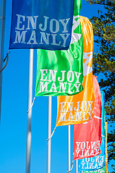 Colourful flags flying at Manly Beach in Australia