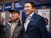 12 DECEMBER 2019 - DES MOINES, IOWA: ANDREW YANG poses for a selfie with a supporter during the opening of his campaign office in Ames, IA. Yang, an entrepreneur, is running for the Democratic nomination for the US Presidency in 2020. He brought bus tour to Ames, IA, Thursday. Iowa hosts the the first election event of the presidential election cycle. The Iowa Caucuses will be on Feb. 3, 2020.        PHOTO BY JACK KURTZ