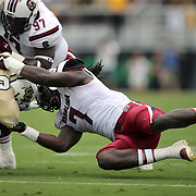 South Carolina Gamecocks defensive end Jadeveon Clowney (7)  tackles UCF Knights running back Storm Johnson (8) during an NCAA football game between the South Carolina Gamecocks and the Central Florida Knights at Bright House Networks Stadium on Saturday, September 28, 2013 in Orlando, Florida. (AP Photo/Alex Menendez)