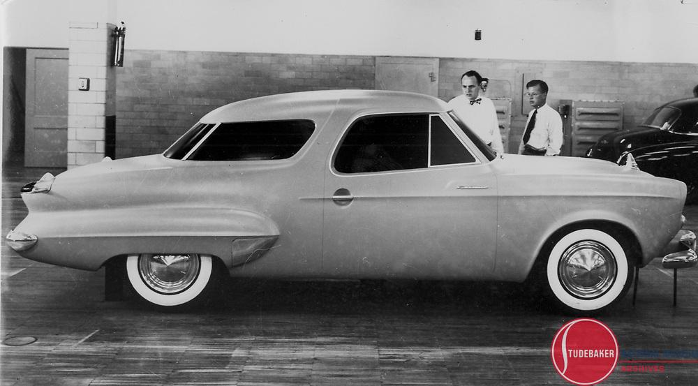 "Studebaker Model ""N"" full size clay model. This design was considered for the 1952 model year. L-R: Robert Bourke, Holden ""Bob"" Koto."