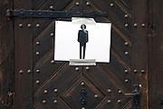 improvised temporary male toilet door sign on an old wooden door