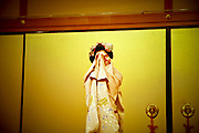 JAPAN- KYOTO - A geisha dancing in a position of hiding the face.  July 2005