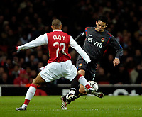 Photo: Ed Godden.<br /> Arsenal v CSKA Moscow. UEFA Champions League, Group G. 01/11/2006. CSKA Moscow's Dudu (R) is tackled by Gael Clichy.
