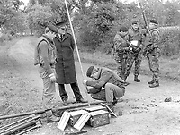 British army sappers prepare to crater a border road between Co Armagh in N Ireland and Co Monaghan in the Rep of Ireland. The cratering was a measure taken to hamper Provisional IRA gun and bomb attacks originating in the Rep of Ireland. 13th October 1971. 197110130427c<br /> <br /> Copyright Image from Victor Patterson, 54 Dorchester Park, Belfast, UK, BT9 6RJ<br /> <br /> t1: +44 28 9066 1296 (from Rep of Ireland 048 9066 1296)<br /> t2: +44 28 9002 2446 (from Rep of Ireland 048 9002 2446)<br /> m: +44 7802 353836<br /> <br /> victorpattersonbelfast@gmail.com<br /> victorpatterson@me.com<br /> <br /> www.victorpatterson.com<br /> <br /> Please see my Terms and Conditions of Use at https://www.victorpatterson.com/page2<br /> It is IMPORTANT that you familiarise yourself with them.<br /> <br /> Images used on the Internet incur an additional cost and must be visibly watermarked i.e. © Victor Patterson within the body of the image and copyright metadata must not be deleted. Images used on the Internet have a size restriction of 4kbs and are chargeable at rates available at victorpatterson.com.<br /> <br /> This image is available only for the use of the download recipient i.e. television station, newspaper, magazine, book publisher, etc, and must not be passed on to any third party. It is also downloaded on condition that each and every usage is notified within 7 days to victorpatterson@me.com<br /> <br /> The right of Victor Patterson (or the named photographer) to be identified as the author is asserted in accordance with The Copyright Designs And Patents Act (1988). All moral rights are asserted.
