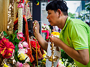 30 SEPTEMBER 2017 - BANGKOK, THAILAND:  A man makes a Navratri altar before the Navratri parade in Bangkok. Navratri is a nine night (10 day) long Hindu celebration that marks the end of the monsoon and honors of the divine feminine Devi (Durga). The festival is celebrated differently in different parts of India, but the common theme is the battle and victory of Good over Evil based on a regionally famous epic or legend such as the Ramayana or the Devi Mahatmya. Navratri is celebrated throughout Southeast Asia in communities that have large Hindu population. Bangkok's celebration of Navratri was subdued this year because Thais are still mourning the death of Bhumibol Adulyadej, the Late King of Thailand, who died on October 13, 2016.     PHOTO BY JACK KURTZ