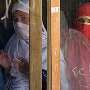 Girls watch the demonstration to Afghan women on setting up water filtration systems, by the 2-27 Female Engagement Team and Waves for Water in the village of Nari, Kunar Province of Eastern Afghanistan.