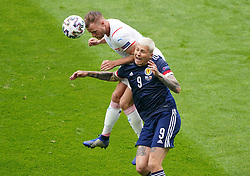 Czech Republic's Tomas Kalas (top) and Scotland's Lyndon Dykes battle for the ball during the UEFA Euro 2020 Group D match at Hampden Park, Glasgow. Picture date: Monday June 14, 2021.