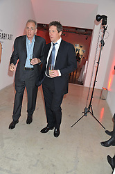 Right, HUGH GRANT at a dinner in aid The Journalism Foundation held at Philips De Pury & Company, Howick Place, London, SW1 on 22nd May 2012.