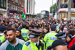 Kesnington, London, July 11th 2014. Vast crowds block Kensington High Street as thousands of Palestinians and their supporters demonstrate against the latest wave of Israeli retaliatory attacks on Palestinian targets and homes, where casualties are steadily mounting.