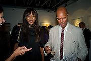NAOMI CAMPBELL; MICHAEL ROBERTS, Book launch for 'Fashion Victims' the Catty Catalogue of Stylish Casualties by Michael Roberts. Hosted by Vanity Fair and Tim Jefferies. Hamiltons. London. 15 September 2008. *** Local Caption *** -DO NOT ARCHIVE-© Copyright Photograph by Dafydd Jones. 248 Clapham Rd. London SW9 0PZ. Tel 0207 820 0771. www.dafjones.com.
