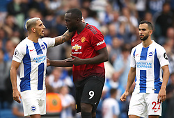 Manchester United's Romelu Lukaku (centre) and Brighton & Hove Albion's Anthony Knockaert (left) after the final whistle