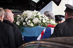 © Licensed to London News Pictures . 11/11/2012 . Lytham Park Crematorium , UK . The coffin is unloaded from the hearse . Hundreds of strangers at the funeral of World War Two veteran Harold Jellicoe Percival today (Monday 11th November 2013) . The funeral is timed to coincide with the First World War armistice , the 95th anniversary of which is at 11am today (Monday 11th November 2013) . The RAF Bomber Command veteran died in his sleep on 25th October 2013 , aged 99 , at Alistre Lodge Nursing Home in St Annes , Lancashire , with no immediate family . Photo credit : Joel Goodman/LNP