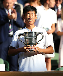 Chun Hsin Tseng with the Trophy after winning the Boys' Singles Final on day thirteen of the Wimbledon Championships at the All England Lawn Tennis and Croquet Club, Wimbledon. PRESS ASSOCIATION Photo. Picture date: Sunday July 15, 2018. See PA story TENNIS Wimbledon. Photo credit should read: Nigel French/PA Wire. RESTRICTIONS: Editorial use only. No commercial use without prior written consent of the AELTC. Still image use only - no moving images to emulate broadcast. No superimposing or removal of sponsor/ad logos. Call +44 (0)1158 447447 for further information.