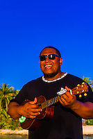 Polynesian man playing a ukelele, Four Seasons Resort Bora Bora, Motu Tehotu, Bora Bora, French Polynesia.