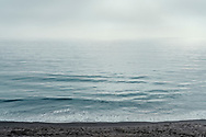 Ocean and low clouds at Summerland Beach, in Summerland, California.