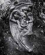 William Rickets Sanctuary - Black and white photo art print of Sculpture of an Aboriginal man and boys in the deep woodland of the Dandenon Mountain near Melbourne Australia. Taken 1993 by Paul Williams,