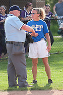 Middletown, New York - A Middletown coach talks to the umpire during a varsity girls' softball game on May 27, 2014.