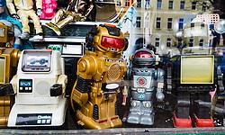 Old vintage toy robots on display in shop window in Prenzlauer Berg, Berlin, Germany
