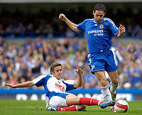 Photo: Daniel Hambury.<br />Chelsea v Portsmouth. The Barclays Premiership. 21/10/2006.<br />Chelsea's Frank Lampard is challanged by Portsmouth's Sean Davis.