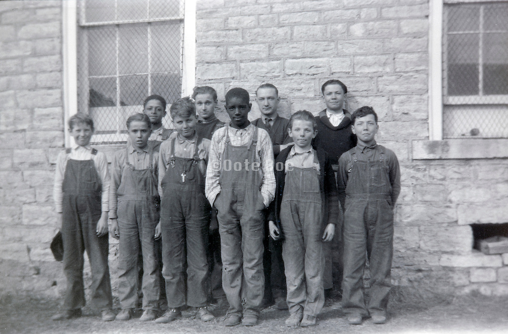 vintage image of school children of which one is of black heritage USA