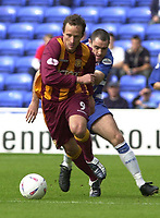 © Peter Spurrier/Sportsbeat Images <br /><br /> <br />04/10/2003 - Photo  Peter Spurrier<br />2003/04 Nationwide Football Div 1 Reading Town FC v Bradford City FC.<br />Nicky Summerbee runs past the tackle from Reading's Andy Hughes.