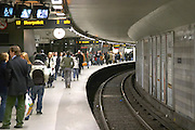 The curved platform with commuters waiting at the Centralstationen, The Central Station. The Stockholm subway. Stockholm. Sweden, Europe.