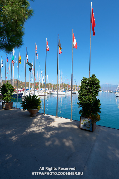 Flags and boats in Fethiye marina, Turkey