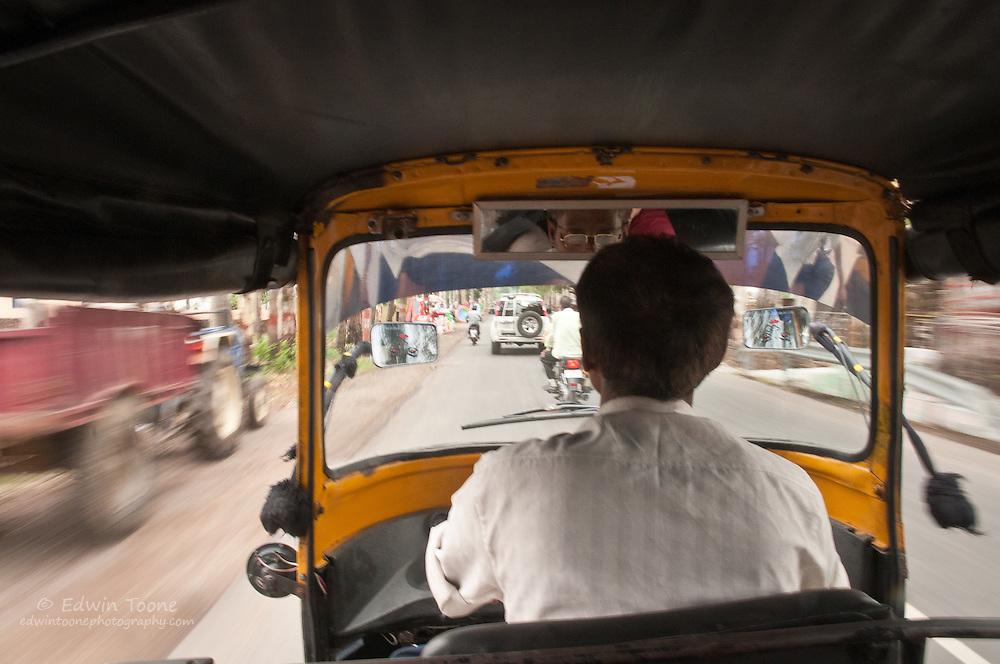 A rickshaw speeds through the streets in Dehradun India.