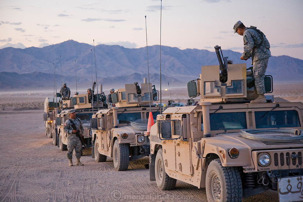Military vehicles with Arabic calligraphy used for training soldiers deploying to Iraq at Medina Jabal, an Iraqi town at Fort Irwin, California, in the Mojave Desert.