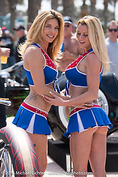 Kristi and Kristi take time from serving up cold ones at the Boot Hill Saloon to model on bikes at the 27th Annual Boardwalk Bike Show during Daytona Bike Week's 75th Anniversary event. FL, USA. Friday March 11, 2016.  Photography ©2016 Michael Lichter.