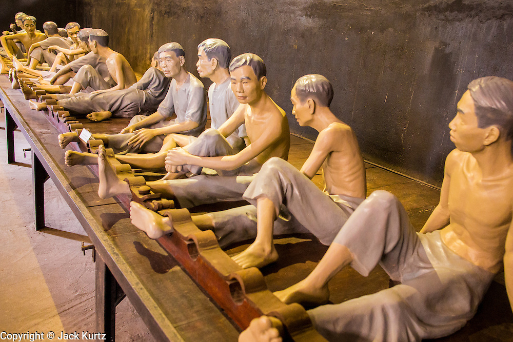 """01 APRIL 2012 - HANOI, VIETNAM: A mock up of what living conditions were like for Vietnamese imprisoned by French colonial authorities in Hoa Lo Prison. After Vietnam's independence the prisons became known infamously as the Hanoi Hilton, in Hanoi, the capital of Vietnam. In colonial times, the French used Hoa Lo to house and torture political prisoners and common criminals. During the """"American War"""" (what the Vietnamese call the war with the US), the prison was used to house American flyers shot down over the north. Most of the prison has been torn down and the grounds turned into an expensive international hotel.          PHOTO BY JACK KURTZ"""