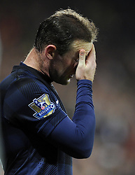 Man Utd Forward Wayne Rooney (ENG) cuts a frustrated figure after seeing his side concede a late equaliser - Photo mandatory by-line: Joseph Meredith/JMP - Tel: Mobile: 07966 386802 - 24/11/2013 - SPORT - FOOTBALL - Cardiff City Stadium - Cardiff City v Manchester United - Barclays Premier League.