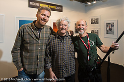 """Jeweler Paolo Langianese (L) and Alfredo """"Biker Billy"""" Cella of Italian Choppers (Middle) and Michael Lichter (R) in the Michael Lichter Photography booth that Billy manned at EICMA, the largest international motorcycle exhibition in the world. Milan, Italy. November 21, 2015.  Photography ©2015 Michael Lichter."""