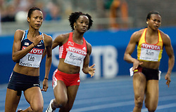 Muna Lee of USA, Kelly-Ann Baptiste of Trinidad and Tobago and Vida Anim of Ghana compete in the women's 200 Metres Semi-Final during day six of the 12th IAAF World Athletics Championships at the Olympic Stadium on August 20, 2009 in Berlin, Germany. (Photo by Vid Ponikvar / Sportida)