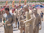 The last section, the mud section, of the Mad Mud Run in the Providence neighborhood of Las Vegas, NV from May 21st, 2011.  The total run was 4.6 miles capped off with about 20 yards of crawling though mud with crowds cheering and booing, (booing if the competitor didn't get really into the mud).