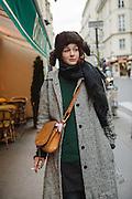 Parisian girl smoking a cigarette on the streets of Paris