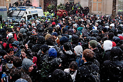 © under license to London News Pictures. 30/11/2010. Snow falls on a crowd of around 500 protesters as they are held by police in Trafalgar Square.  Students demonstrated in London for the third time against the raising of tuition fees.  Credit should read Matt Cetti-Roberts/London News Pictures