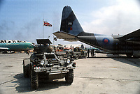 A British army Ferret armoured car guards a RAF C130 Hercules aircraft unloading a logistical supply run in Beirut which was scheduled weekly. June 1983 photographed by Terry Fincher