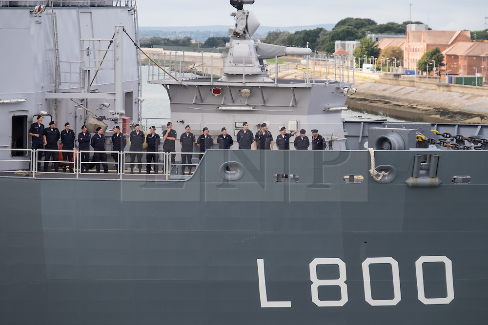© Licensed to London News Pictures. 22/09/2016. Portsmouth, UK.  Crew members standing to attention on the bow of the Dutch Warship, HNLMS Rotterdam, which is visiting Portsmouth Harbour today, 22nd September 2016. The Rotterdam is a Landing Platform Dock amphibious warfare ship of the Royal Netherlands Navy. The vessel is visiting for the day, and will depart this evening at approximately 1700 hours. Photo credit: Rob Arnold/LNP
