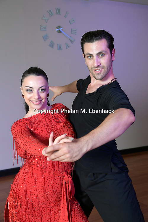 Hayk Balasanyan, right, and Emilia Poghosyan, owners of the Fred Astaire Dance Studio in Winter Park, Fla., perform a routine in their business Wednesday, Aug. 16, 2017, in Winter Park, Fla. (Photo by Phelan M. Ebenhack)