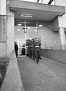 Body of Private Stephen Griffin killed in Lebanon is returned to his home soil..1980-04-19.19th April 1980.19-04-1980.04-19-80..Photographed at Dublin Airport Mortuary..Comrades of Private Stephen Griffin carry his coffin from the mortuary chapel. The pallbearing party is from the 2nd Garrison Military Police. The coffin is draped in the Irish and United Nations flags.