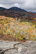 Beacon Heights is a scenic half-mile round trip walk with 130 feet gain from Blue Ridge Parkway Milepost 305.2 in Pisgah National Forest, North Carolina, USA. Enjoy fall leaf colors in mid October atop an outcropping of quartzite rock. (Photographed October 12, 2015). Beacon Heights Parking Area (elevation 4220 feet) is near the intersection with Hwy 221 (near Grandfather Mountain Entrance Road). This trail also connects with the Tanawha Trail (13.5 miles to Price Lake) and the Mountains to the Sea Trail. The 469-mile Blue Ridge Parkway was built 1935-1987 to aesthetically connect Shenandoah National Park (in Virginia) with Great Smoky Mountains National Park in North Carolina, following crestlines and the Appalachian Trail. The Blue Ridge Mountains are a subset of the Appalachian Mountains.