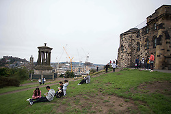 © Licensed to London News Pictures. 15/08/2020 Edinburgh, UK. Members of the public waiting at Calton Hill in Edinburgh to observe The Red Arrows flypast to mark the 75th anniversary of VJ day, which has now been cancelled due to bad weather. Photo credit: Marcin Nowak/LNP