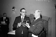 24/05/1966<br /> 05/24/1966<br /> 24 May 1966<br /> Players and Wills trophies presented for Gaelic League Inter Branch Debating Competition. Mr. P.J. Lavery, Director of Player and Wills (Ireland) Ltd. handed over a set of solid silver trophies and cheques to Cathal Ó Feinneadha, Uachtarain, Conradh na Gaeilge, for an All Ireland gaelic League Inter-Branch Debating Competition The presentation took place at the new Conradh na Gaeilge headwaters at Harcourt Street, Dublin. Picture shows Mr. Lavery (right) handing over the major trophy to Mr. Ó Feinneadha.