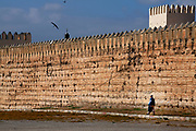 A man walks past the King's Palace walls in Fes, Morocco on Monday morning, May 28, 2007. (PHOTO BY TIMOTHY  D. BURDICK)