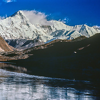 Cho Oyu, the world's 8th highest peak reflects in a in lake in Gokyo Valley, in the Khumbu region of Nepal's Himalaya.