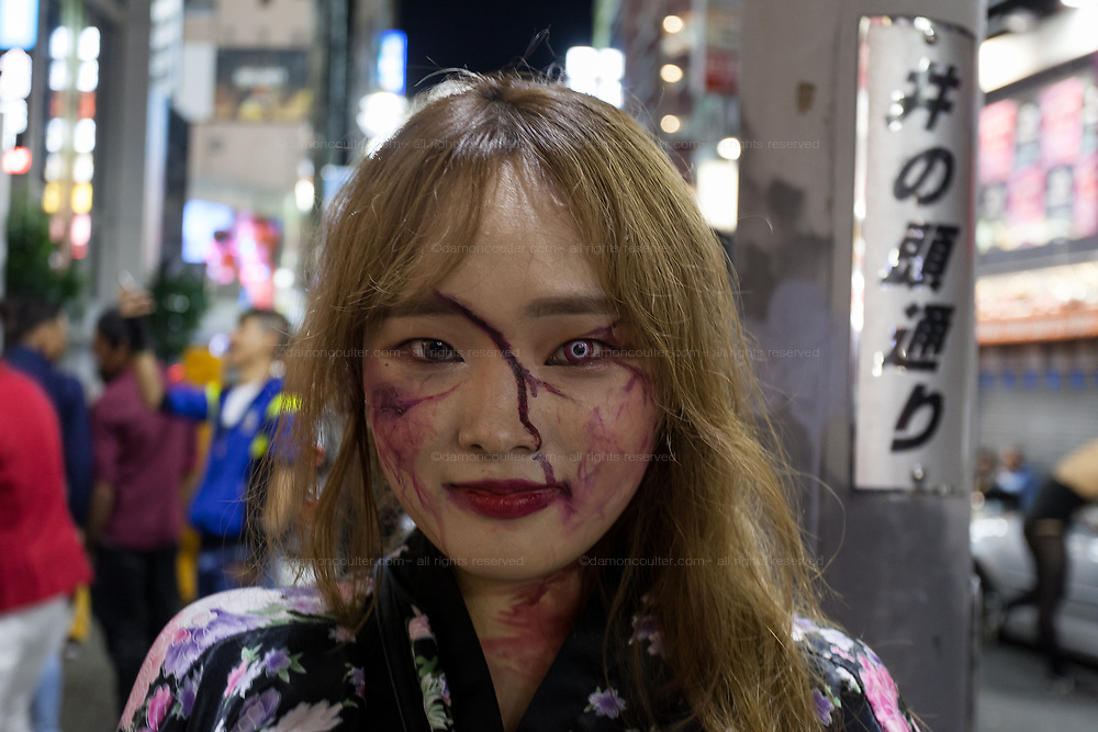A Japanese woman in costume during the Halloween celebrations Shibuya, Tokyo, Japan. Saturday October 27th 2018. The celebrations marking this event have grown in popularity in Japan recently. Enjoyed mostly by young adults who like to dress up, drink , dance and misbehave in parts of Tokyo like Shibuya and Roppongi. There has been a push back from Japanese society and the police to try to limit the bad behaviour.
